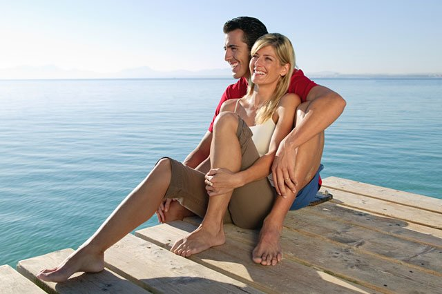 couple sitting on dock